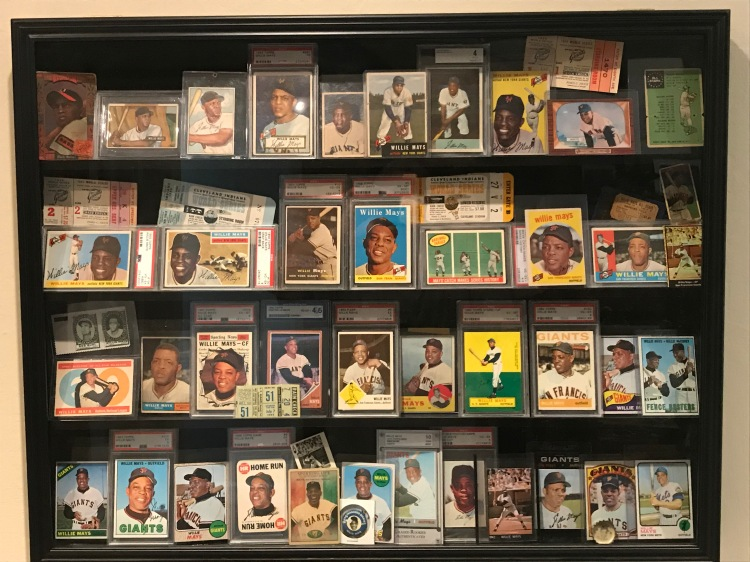 Display case of Willie Mays baseball cards.